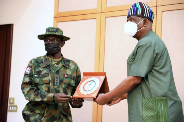 Governor of Rivers State, Nyesom Ezenwo Wike (right) receives a plaque from the Chief of Defence Staff, General Lucky Irabor during the latter's courtesy call at the Government House, Port Harcourt on Friday.
