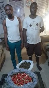 Picture showing the suspects, the live ammunition, the bag of Indian hemp.