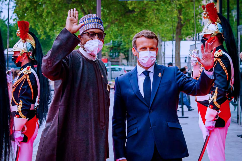 President Buhari and President Macron on arrival of the Nigerian president at  Grand Palais Éphémère for the Plenary Session of the African Finance Summit in Paris, France on 18th May 2021