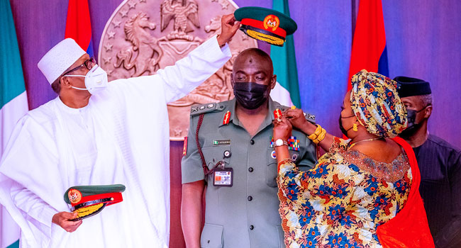 President Buhari decorating the late Attahiru soon after he was appointed the COAS earlier this year