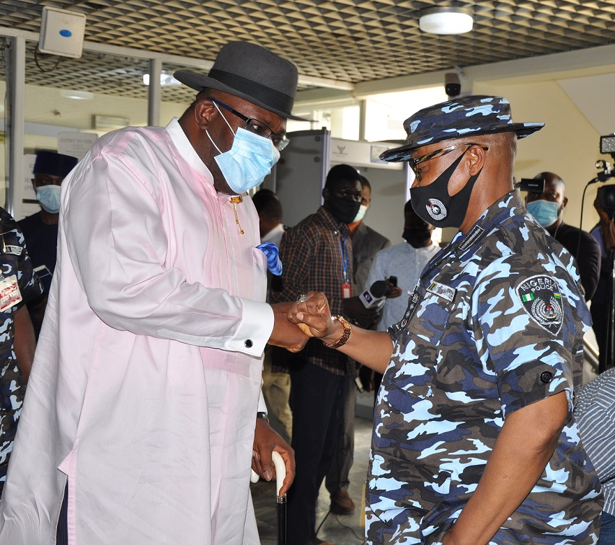 Sen Dickson and Acting Inspector-General of Police (I-G), Mr Usman Baba.