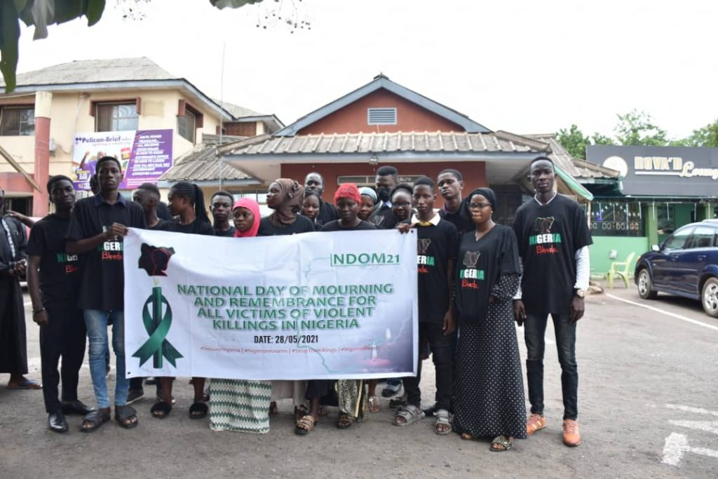 Members of Joint Action Civil Society Coalition in Ogun State during a rally  to mark this year National Day of Mourning in remembrance of people that have lost their lives to one crisis or the other across the country on Friday