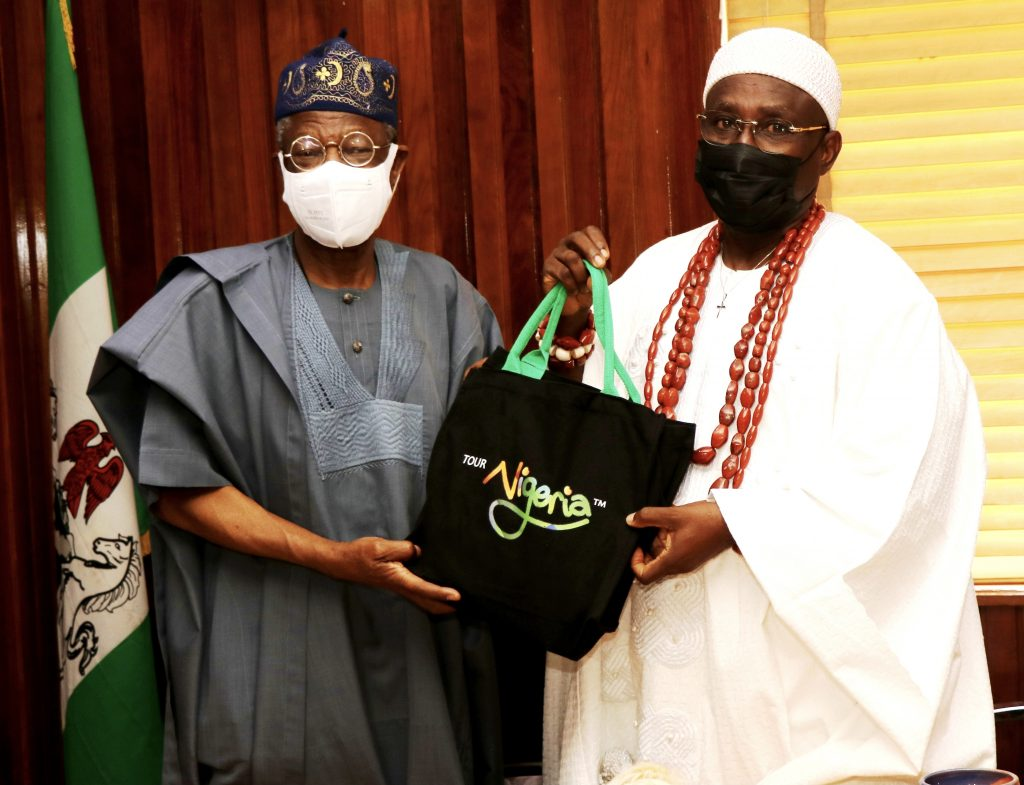 L-R: The Minister of Information and Culture, Alhaji Lai Mohammed, presenting a souvenir to the Oluyin of Iyin-Ekiti, Oba Adeola Adeniyi Ajakaiye, during a courtesy visit to the Minister by the Royal Father in Abuja on Thursday.