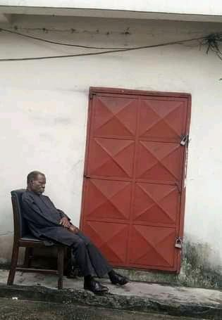 The landlord sitting at the entrance to the PHEDC office