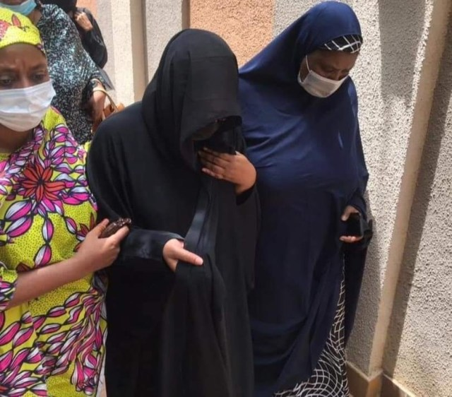 Fati, wife of the late COS supported by sympahthisers during funeral service for her husband at the National Mosque