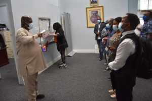 Egopija attending to passport applicants at the Nigeria House in New York to help ease pressure on consulate officials.