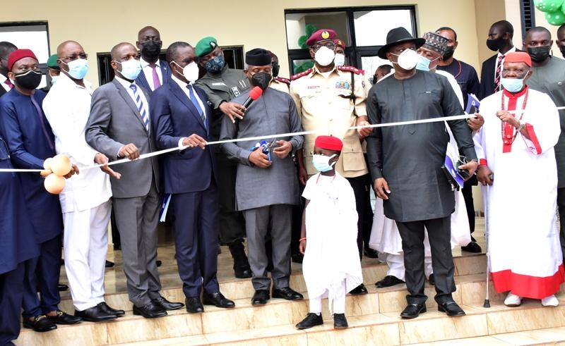 Vice President Yemi Osinbajo (4th right); cutting the tape to inaugurate FRSC Marshal Inspectorate Training School, Owa-Alero, Delta State, built by Delta State Government. With him are Delta Governor, Senator Dr Ifeanyi Okowa (4th left); his Deputy, Mr Kingsley Otuaro (2nd left); Minister of State for Labour and Productivity, Festus Keyamo, SAN (2nd right); Corps Marshal, FRSC, Boboye Oyeyemi (3rd right); HRM, Dr Emmanuel Efeizomor II, Obi of Owa (right); Chairman, FRSC Board, Mallam Bukhari Bello (3rd left) and Minority Leader, House of Representatives, Rt .Hon Ndudi Elumelu (Left) Thursday.