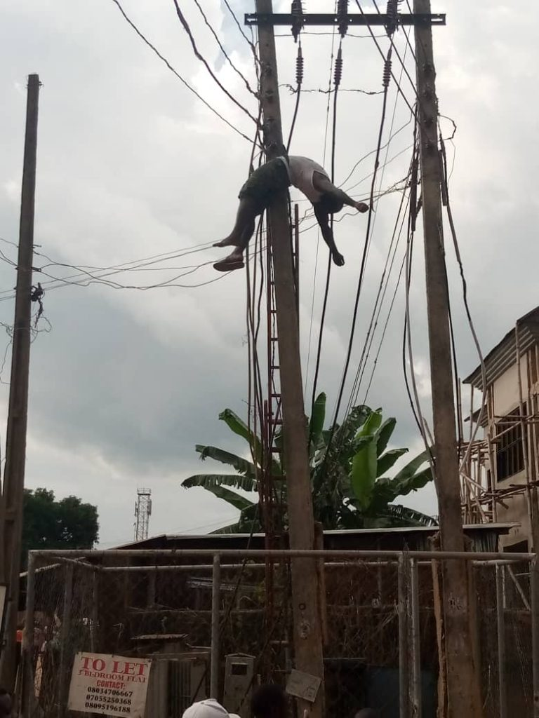 The remains of the man dangling on the pole after he was electrocuted to death
