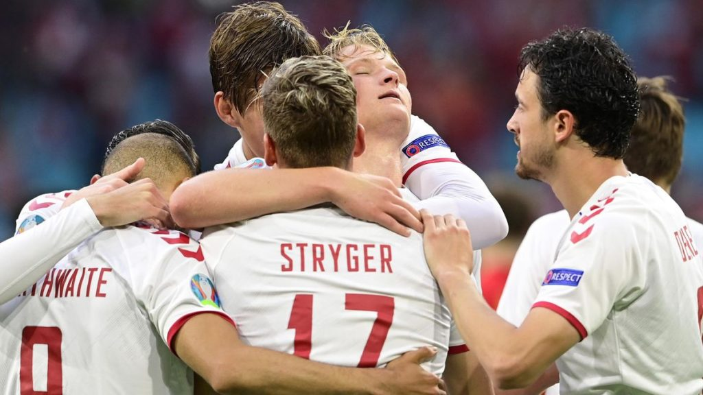 Denmark players celebrate Kasper Dolberg who inspired a convincing 4-0 win for Denmark over Wales on Saturday and took them into the quarter-finals of Euro 2020.