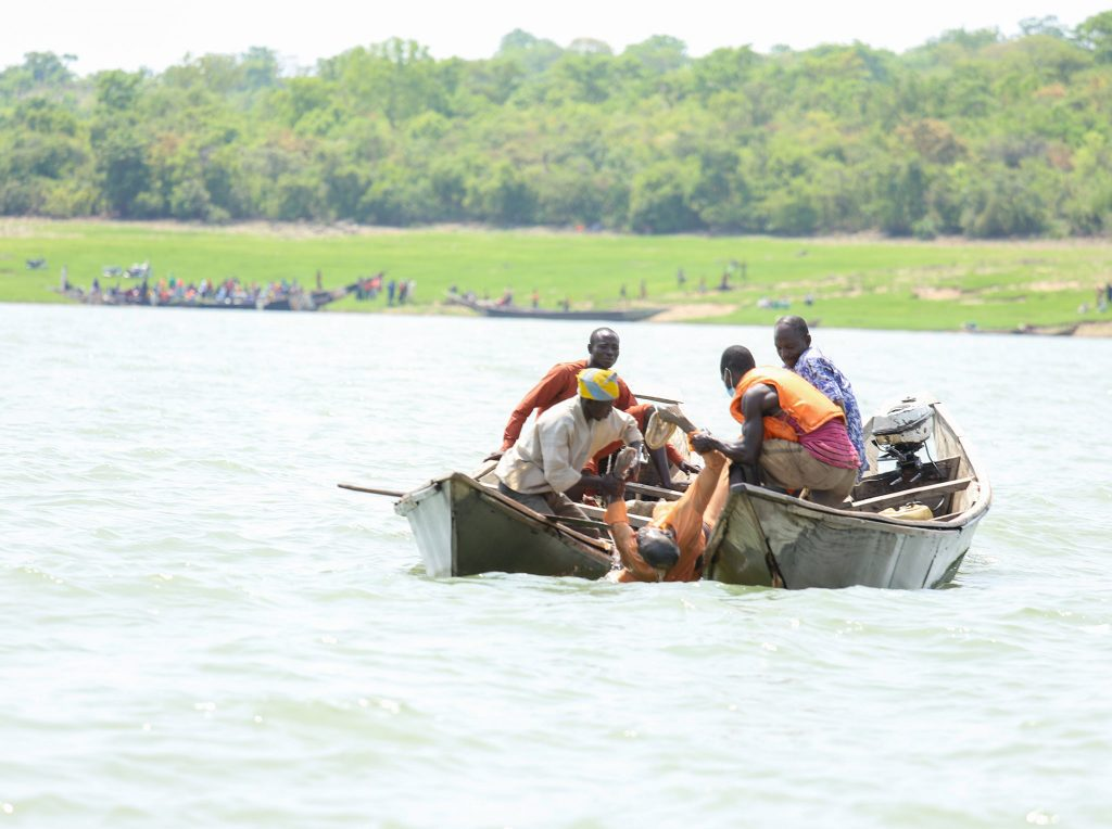 Remains of one the victims being recovered during search and rescue efforts at a scene of a boat mishap at Warrah, Ngaski Local Government Area of Kebbi state.