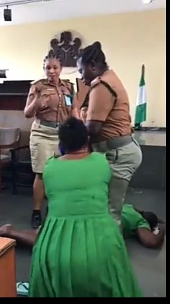 The female convicts, Ada Ebere and Favour Godwin resisting attempt to take them to prison after their conviction in a  child theft suit