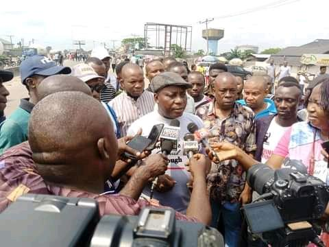 Comrade Celestine Akpobari a humanrights activist and APC Chieftain speaking to Journalists at the venue of the protest.