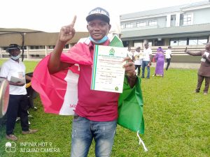 PDP Councillor-elect, Adesola Thomas, displaying his Certificate of Return following victory at Ward G of Yaba LCDA at the July 24 council poll in Lagos State