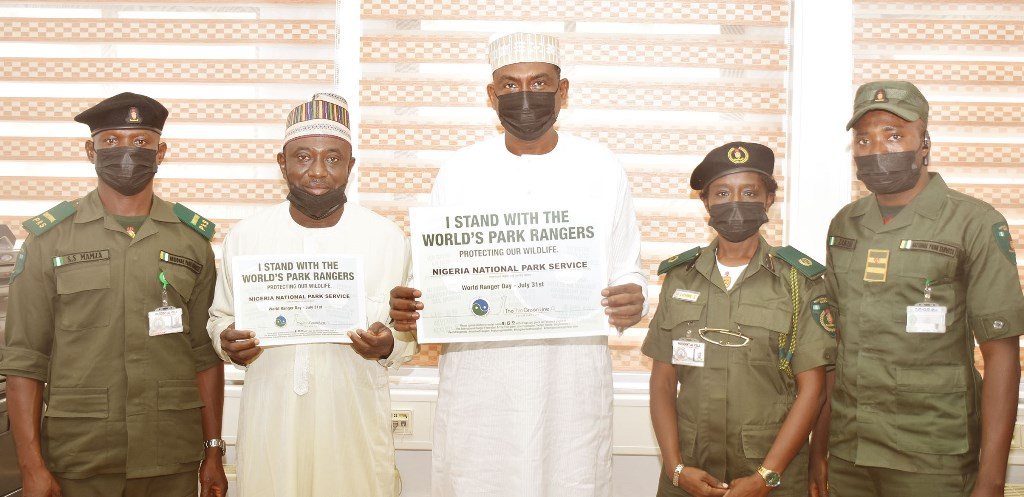 Salihu  Manzo, Senior Park Ranger, State House,  Dr Haruna Tanko, Head Veterinary Unit, State House, Tijjani Umar, Permanent Secretary, State House,  Kehinde Abidemi, Assistant Conservator of Parks and WildLife Curator, State House, and Zakari Ibrahim, Assistant Park  Inspector, during a courtesy visit to the Permanent Secretary, State House as part of activities to commemorate World Ranger Day. Friday, July 30, 2021