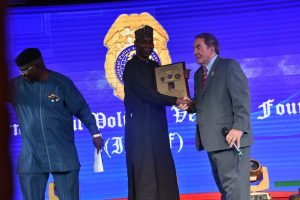 Nigeria's Ambassador to the UN, Prof. Tijjani Muhammad-Bande (Middle), receiving the Global Leadership in International Relations Award by the International Police and Veterans Foundation in New York