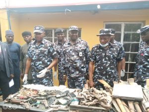 AIG Umar Muri displaying assorted arms recovered from criminals on Friday in Kaduna.
