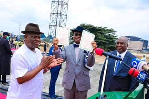 Governor Nyesom Wike presenting Certificate of Occupancy  (C of O) of the land on which the law school campus  and the Staff Quarters are being built to Nnaemaka Ngige, SAN,  the representative of Abubakar Malami, the AGF and Minister Justice