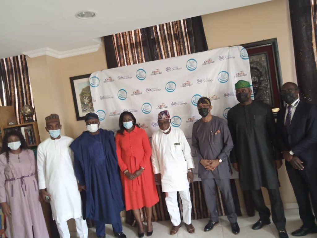 Former President Olusegun Obasanjo (third from right) and the team from Global Oncology (GO).
