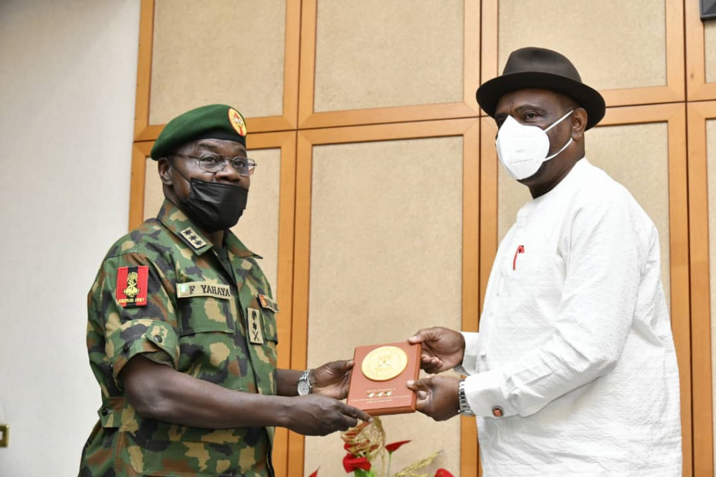 Governor of Rivers State, Nyesom Ezenwo Wike (rights) receives a plaque from the Chief of Army Staff, Lt. General Farouk Yahaya during the latter's courtesy call at the Government House, Port Harcourt on Monday.