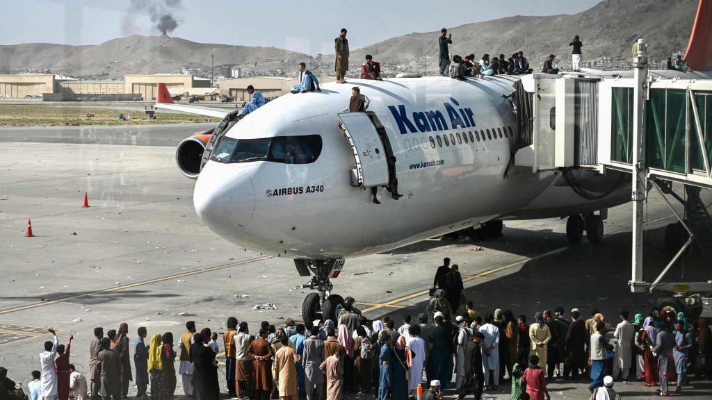Desperate Afghans besiege Kabul Airport to get out of the country after take over by the Taliban