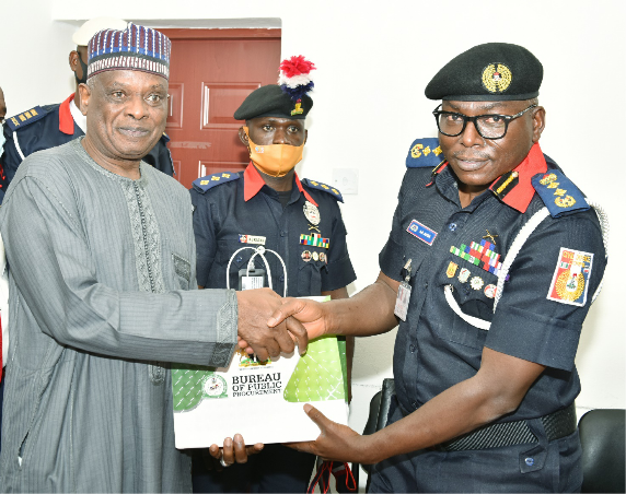 L-R: Director-General, BPP, Mamman Ahmadu, FNIQS presenting a set of the BPP document to the Commandant General, NSCDC, Dr. Ahmed Abubakar Audi during the courtesy visit