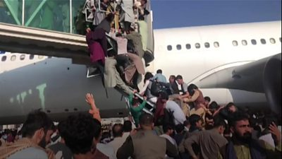 Chaotic scene at Kabul airport on Monday as Afghans rush to leave Afghanistan after Taliban's takeover