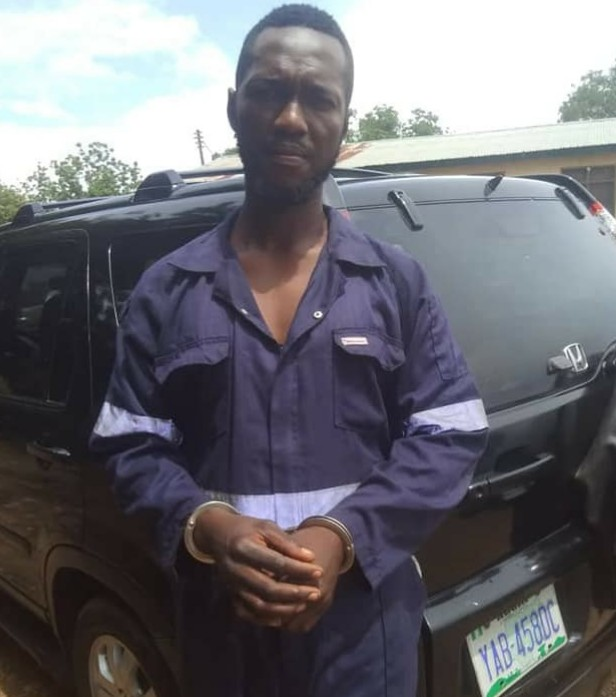Ifeanyi with the stolen car