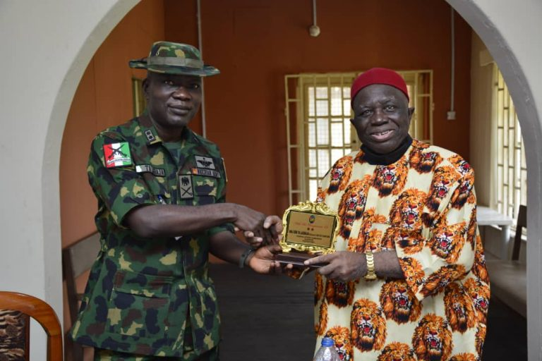 President-General of the apex Igbo socio-cultural organisation, Prof. George Obiozor, presents a plaque to  the General Officer Commanding (GOC), 82 Division, Maj.-Gen. Taoreed Lagbaja, visited him in his office in Enugu on Wednesday