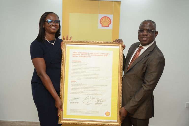 Managing Director, Shell Nigeria Exploration and Production Company Limited SNEPCo, Mrs. Elohor Aiboni receiving the Shell Safety Environment and Social Performance Charter from her predecessor