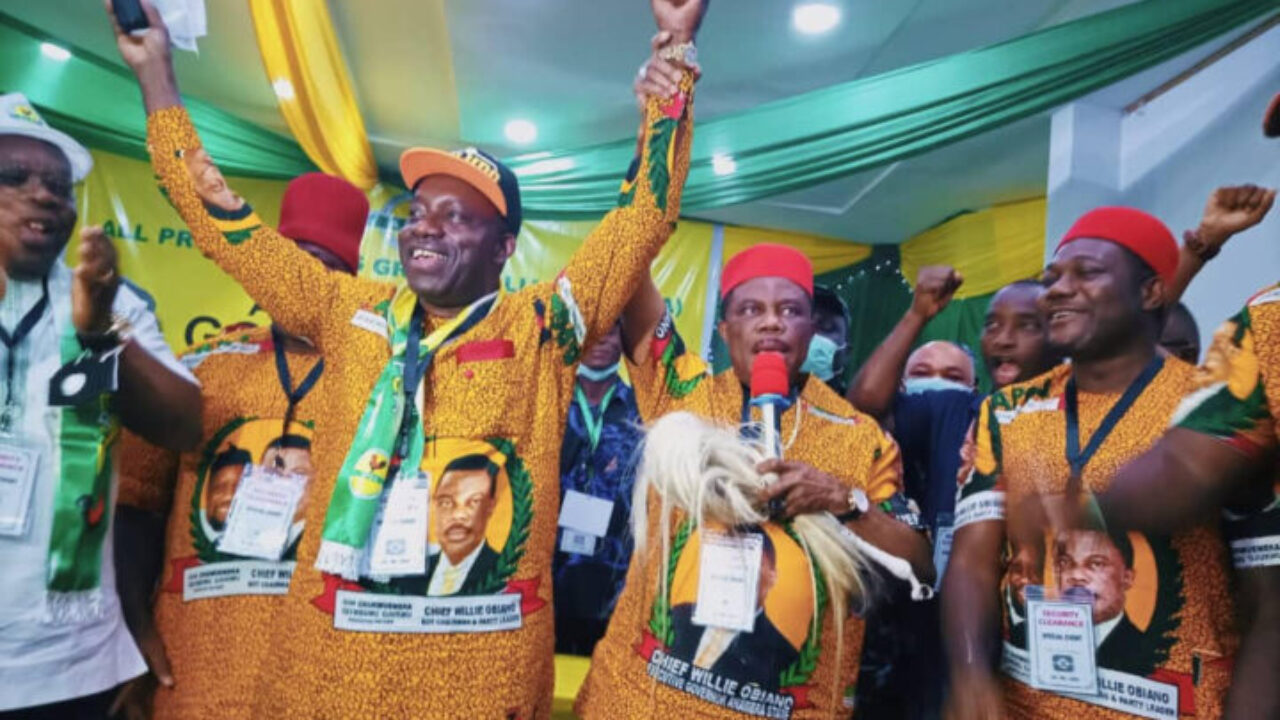 Governor Willy Obiano lifts Soludo;s hands up when he was declared winner of APGA primary