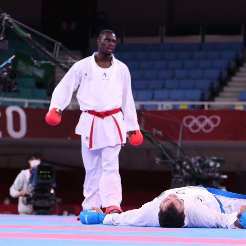 Saudi Arabia's Tareg Hamedi disqualified for a kick to Iran's Sajad Ganjzadeh head in men's +75kg kumite Olympic  karate. The Iranian (on the floor) was declared winner of the gold medal  after high drama at the famed Budokan arena on Saturday.