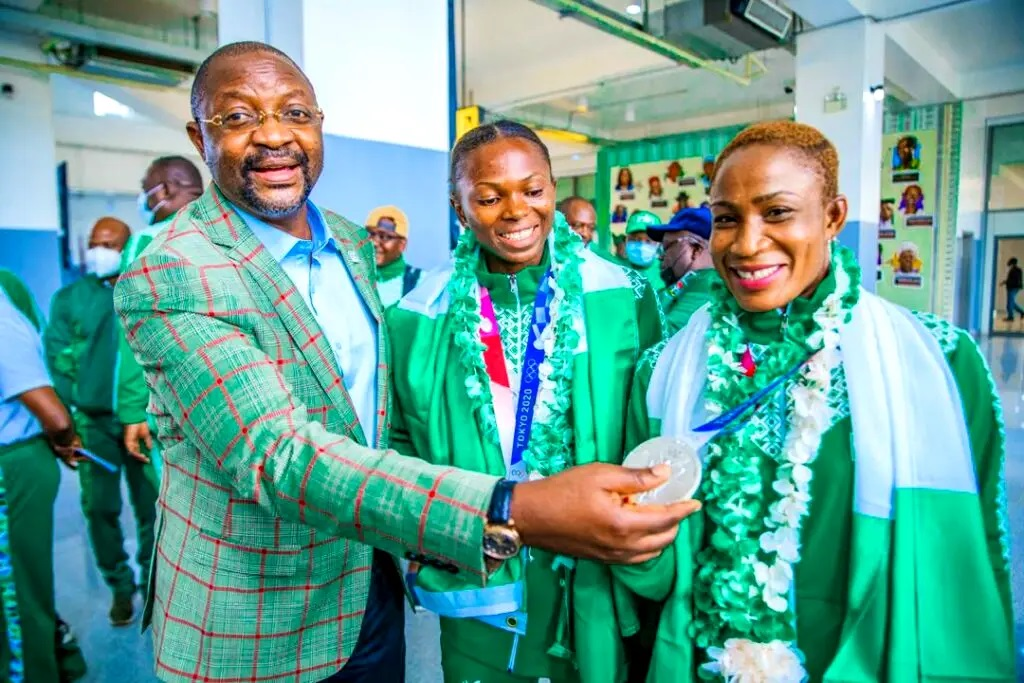 Minister of Youths and Sports, Sunday Dare welcoming Silver winning wrestler Blessing Oborududu and Long Jump Bronze medalist, Ese Brum from Tokyo Olympics