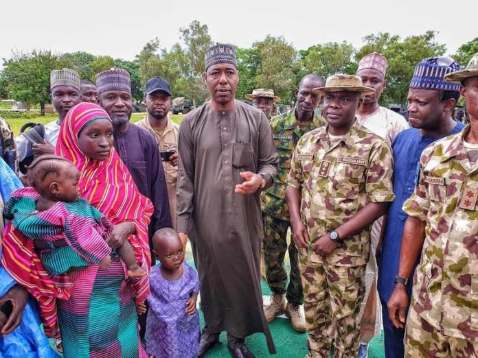 Left: Hassana and her two children being handed over to Governor Babagana Zulum in Gwoza on Saturday