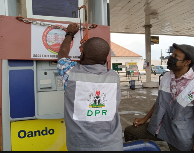 DPR officials unsealing a filling station sealed by the Lagos State Building Control Agency on Thursday in Lagos
