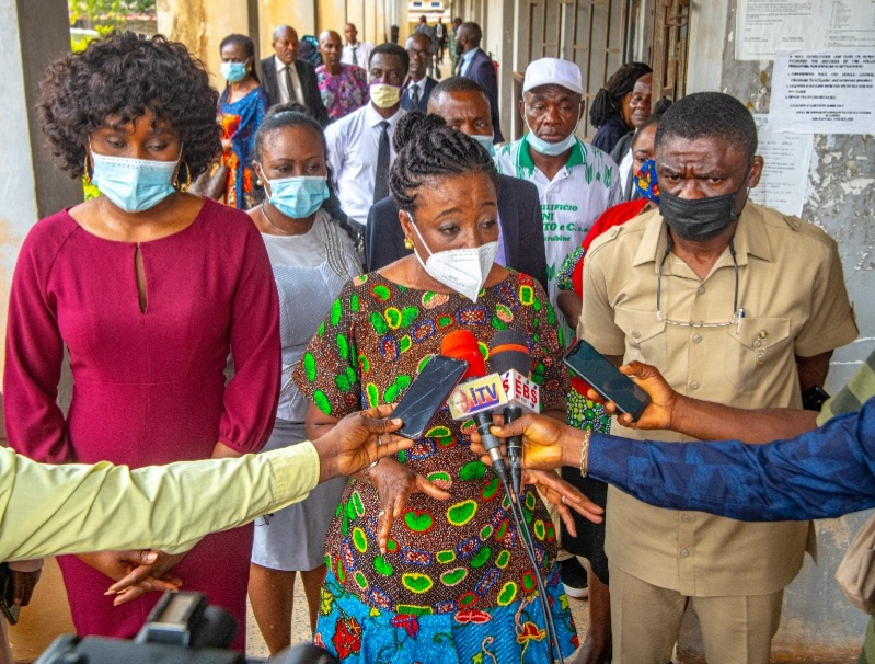 Edo First Lady, Mrs Betsy Obaseki, flanked by the Deputy Governor of Edo State, Philip Shaibu and his wife Maryann Shaibu, speaking to journalists at the court premises