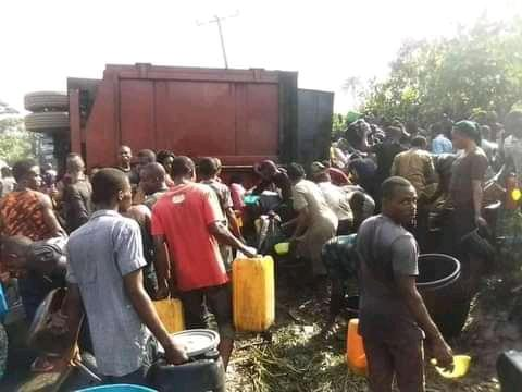 People scooping diesel from fallen  tanker at Etche road in Etche local government area of Rivers