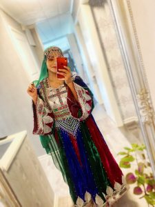 A woman poses in traditional Afghan attire, in Stockholm, Sweden, March 21, 2021, in this picture obtained from social media. Wazhma Sayle/via REUTERS