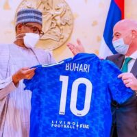 FIFA President Gianni Infantino presents No 10 jersey to Buhari during the visit of the FIFA delegation to Presidential Villa