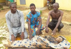 lsmail Saliu,(without shirt) conspired with two others to kill his brother for money ritual, in Kosubosu, Kwara state