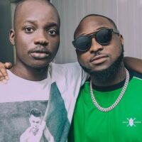 Right to left: Davido and his official photographer, Fortunate Umunname Peter, aka Fortune who died on Tuesday evening