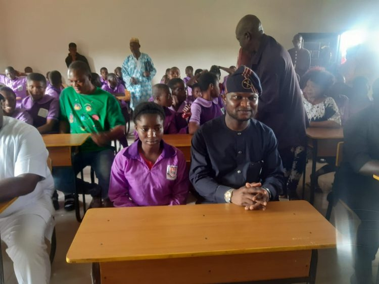 Photo: Mr. Dennis Idahosa with the students in one of the newly constructed classrooms