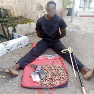 The alleged police sergeant with the ammunition found in his possession when he was arrested