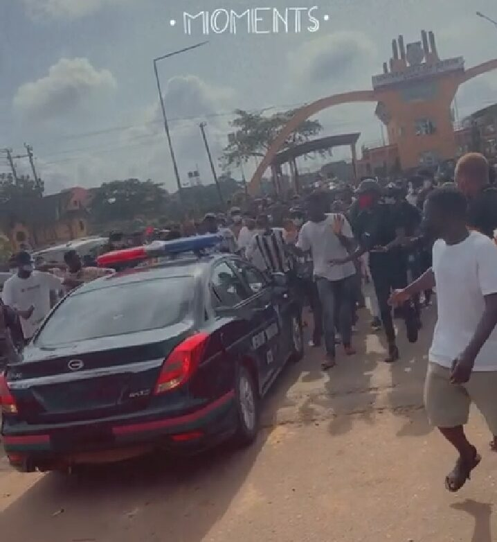 UNIBEN Students turning away a security vehicle at the gate of the university on Wednesday