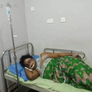 The victim on her hospital bed