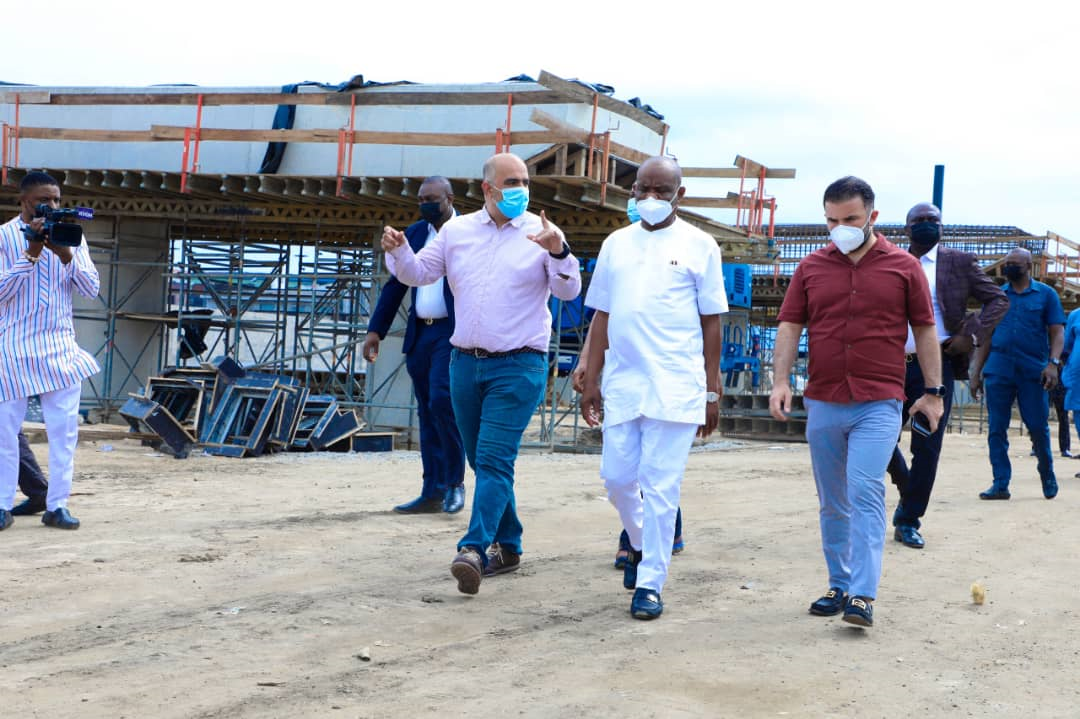 Governor of Rivers State, Nyesom Ezenwo Wike (middle) and  the Project Manager, Julius Berger Nigeria Plc, Engineer Taner  (left) during inspection of work at the  Nkpolu -Oroworukwo Flyover, Port Harcourt on Sunday.