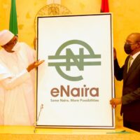 President Muhammadu Buhari and the Governor of the Central Bank of Nigeria, Godwin Emefiele during the launch of Nigeria's Digital Currency (CBDC), e-naira at Aso Rock presidential villa on Monday